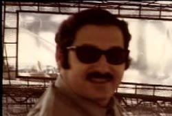 Smiling Ted Loseff with sunglasses and a mustache
