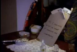 """Ted Loseff's """"suicide note"""" on a table with small relics"""