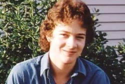 Smiling Tommy Burkett with curly brown hair
