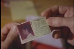 Someone holding Tommy's drivers license