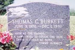 "Grave stone that reads ""Thomas C. Burkett June 9, 1970 - Dec 1, 1991"""