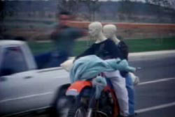 A recreation of the crime with dummies on the motorcycle