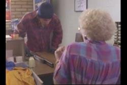 Suspect aiming shotgun at Opal Johnson at the post office