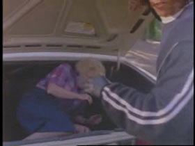 Suspect forcing opal into the trunk of a car