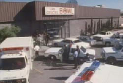 Police and paramedics arriving at the bowling ally where the shooting took place