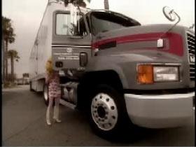 Hazel head opening the passenger door of a semi truck