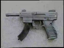 Pistol with extended magazine attatchment