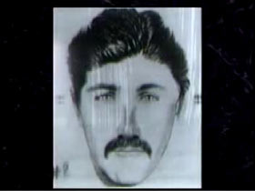 Police Sketch of a Caucasian man with dark hair dark eyes and a mustache