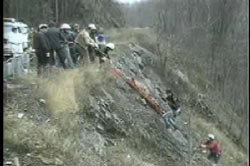 Search party recovering Sherry Hart's body from the bottom of a cliff