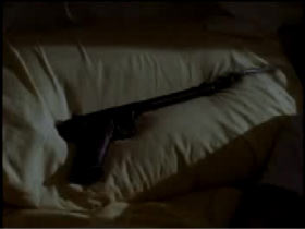 Pistol laying across a pillow