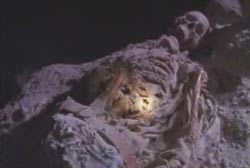 Skeletal remains of Gary Simmons in a dark cave