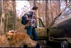 Bishop leaving his car in the middle of a Tennessee forest with his golden retreiver on a leash